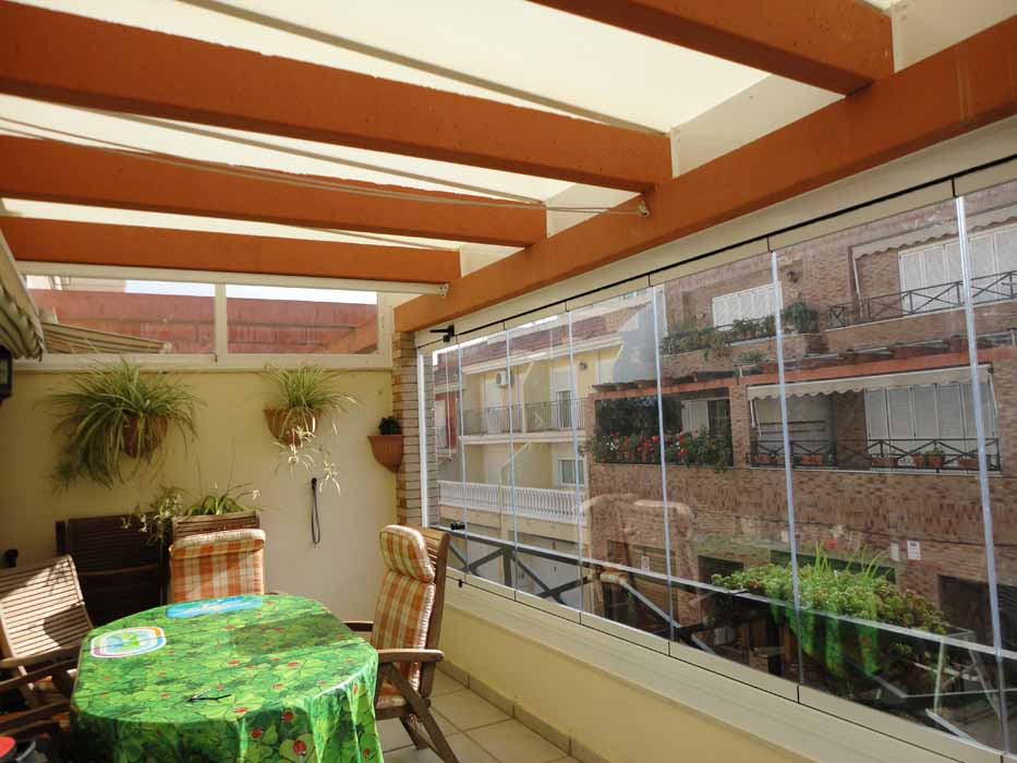 Techos para terrazas ticos y patios castell n y for Rieles para toldos de techo