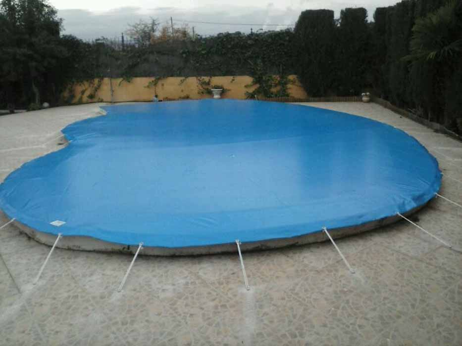 Toldos y lonas para cubrir piscinas en castell n toldos for Fundas para piscinas